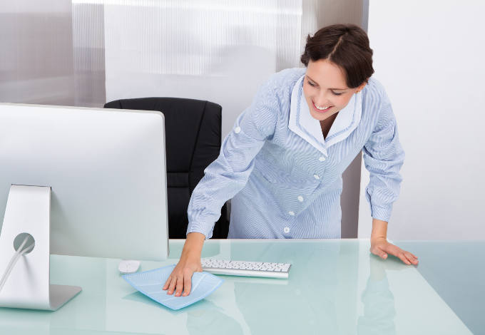 Woman Cleaning Desk Image